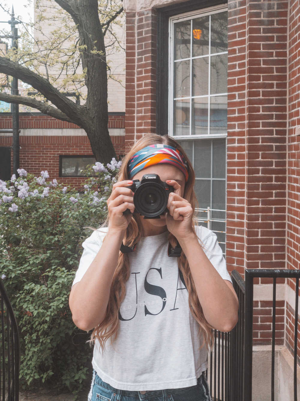 caitlin patton, chicago blogger, take a photo with a canon camera to post on Instagram